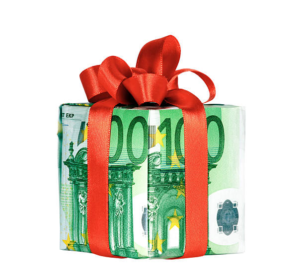 A money notes gift box with bow stock photo