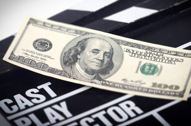 money on a movie clapper stock photo