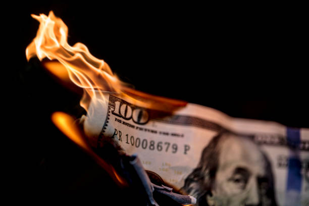 Money on Fire A stock photo of 100 dollars on fire. Please note the money is not real and is marked