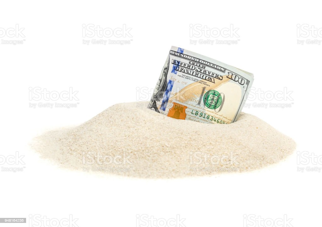 Money on heap of sand. Isolated on white. stock photo
