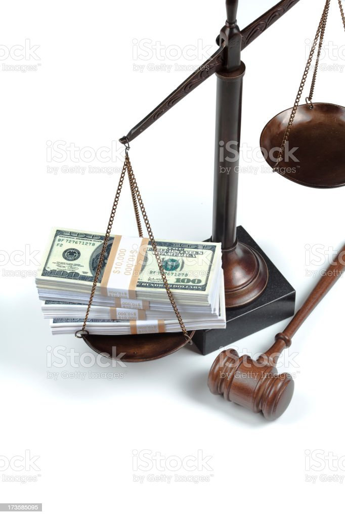US money on scale of justice royalty-free stock photo