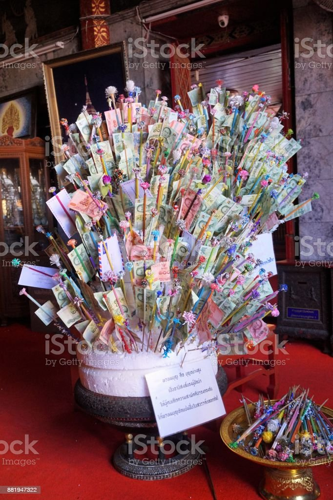 Money on sticks in temple in Thailand stock photo