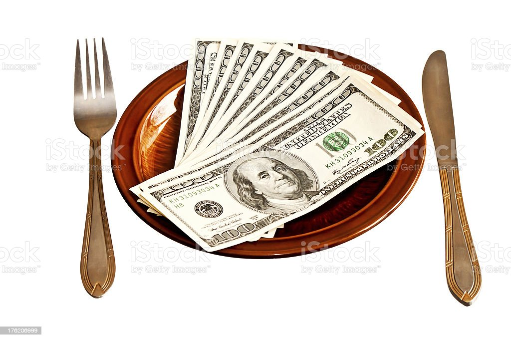Money on the plate with fork and knife royalty-free stock photo