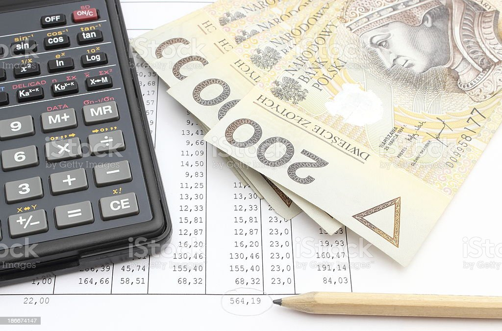 Money, pencil and calculator lying on spreadsheet royalty-free stock photo