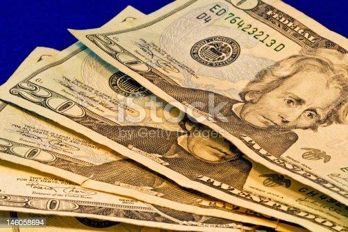 Close up of four american twenty dollar bills showing Andrew Jackson