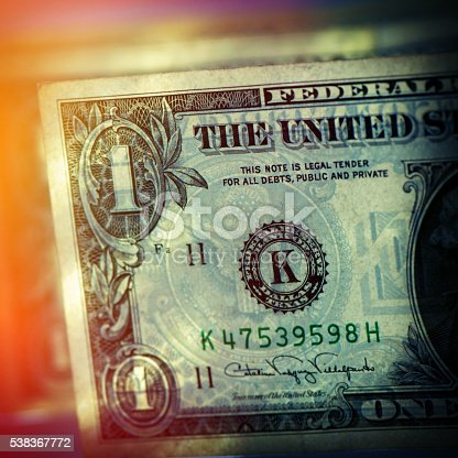 three paper banknotes of denomination one dollar