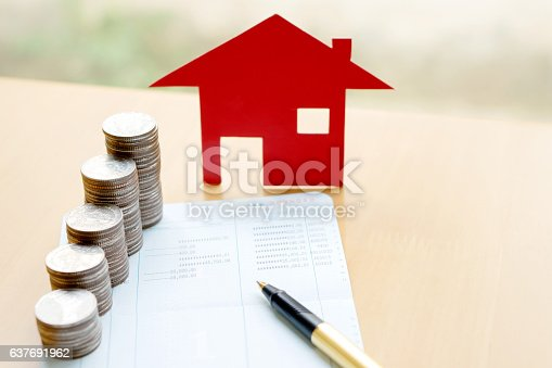 istock money, pile coin with saving book and paper home,concept 637691962