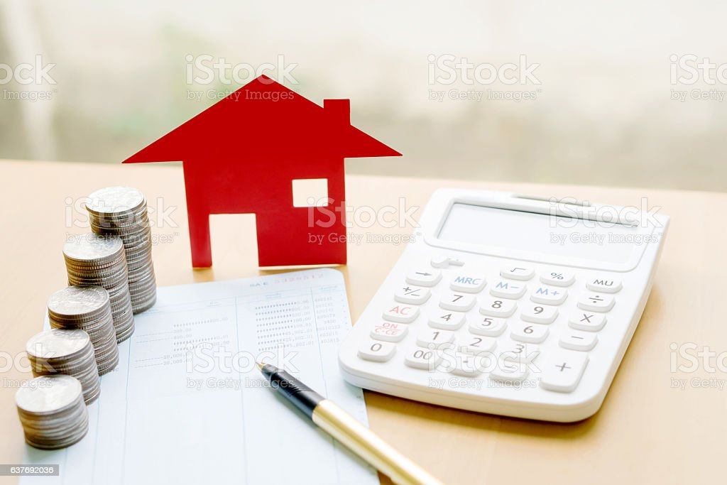 money, pile coin with saving book and paper home,concept stock photo