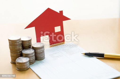 istock money, pile coin with saving book and paper home,concept 639230746