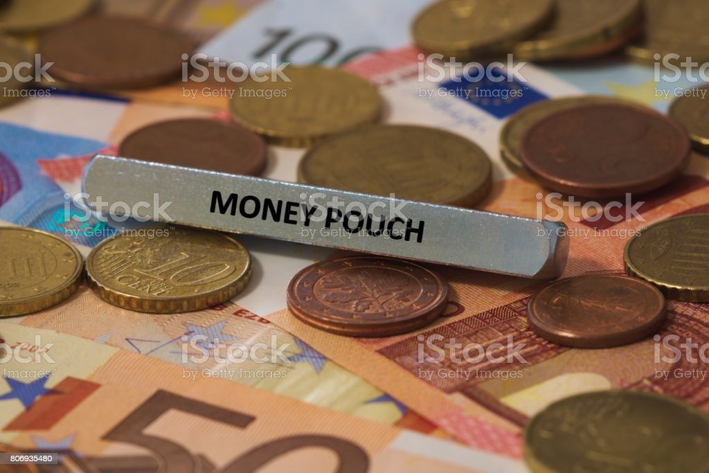 money pouch - the word was printed on a metal bar. the metal bar was placed on several banknotes stock photo