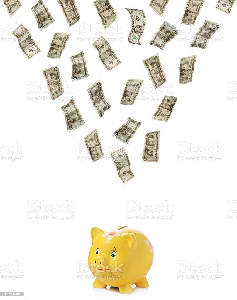 Money raining down on a piggy royalty-free stock photo