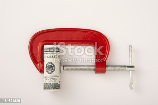 Money clamped in the clamp on a white background