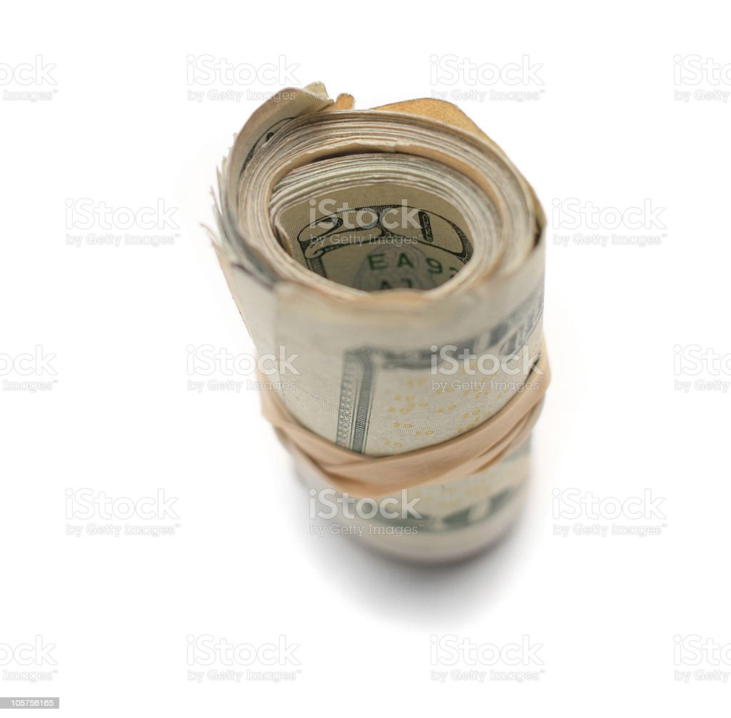 Money Roll with Rubber Bands on a White Background royalty-free stock photo