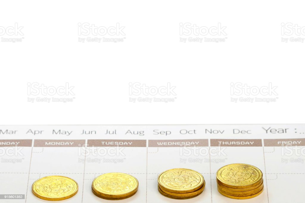 money saving concept,coins on day schedule calendar with copy text space stock photo