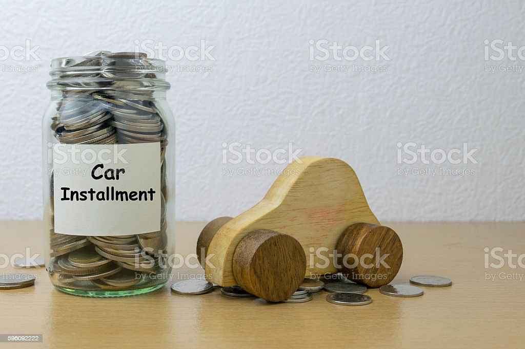 Money saving for Car installment in the glass bottle royalty-free stock photo