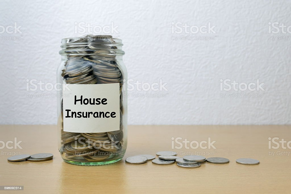 Money saving for house Insurance in the glass bottle royalty-free stock photo