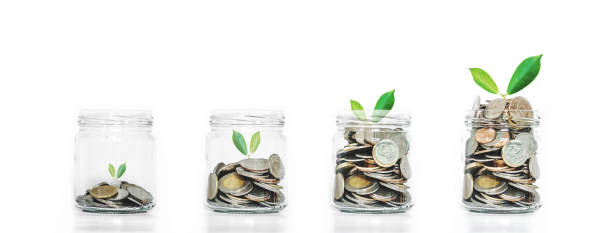 Money saving growth concepts, glass jar with coins stock photo
