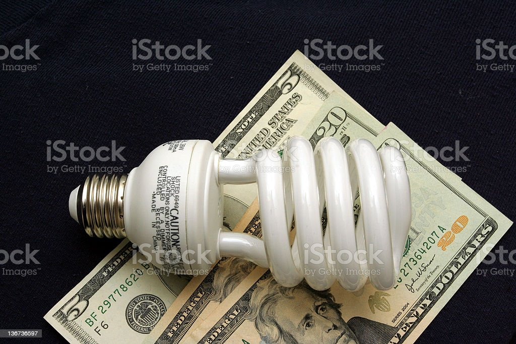 Money saving light bulb royalty-free stock photo