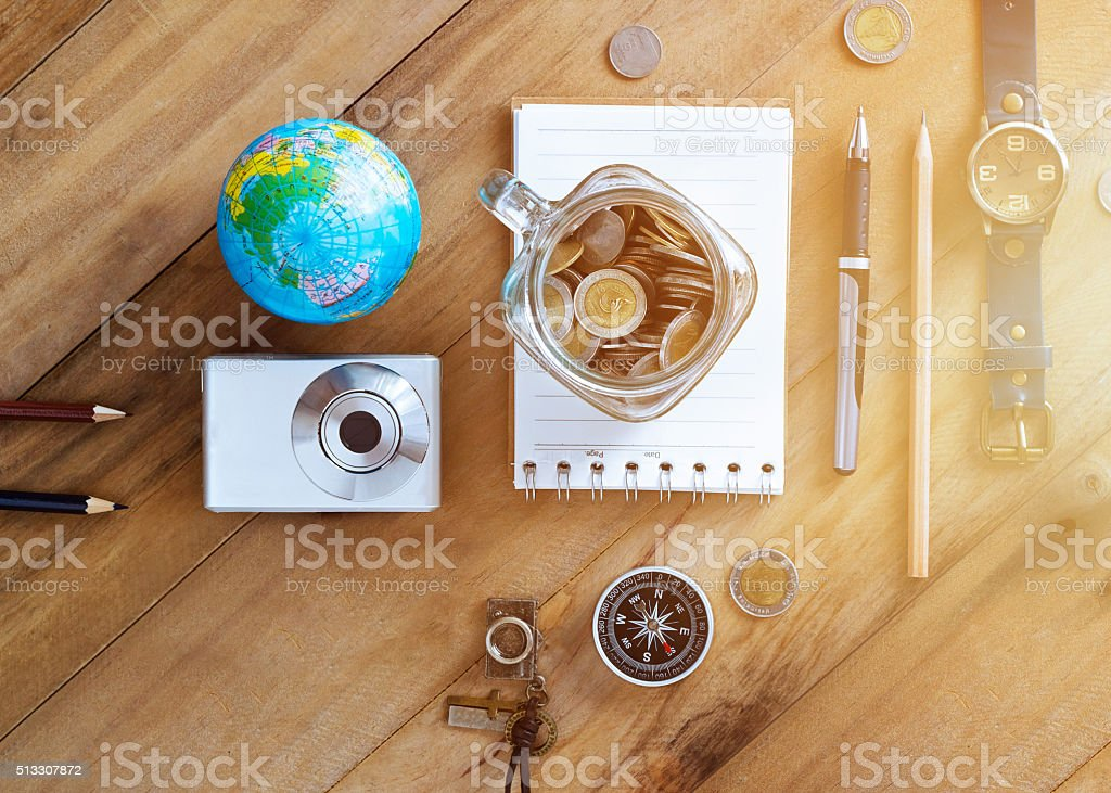 Money savings in a glass jar on wooden background stock photo