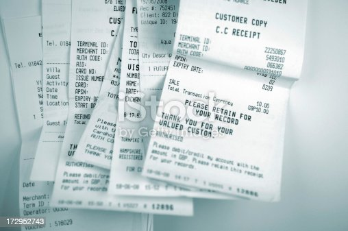 blue selective focus image of till receipts