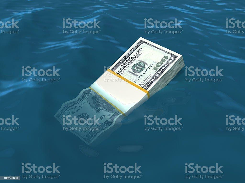 Money sinking in water. US Dollars. stock photo