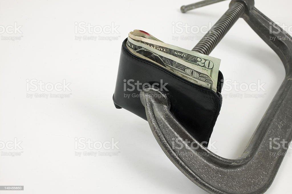Money sqeeze stock photo