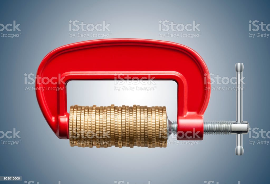 Money squeeze. Clamp with coins. - Foto stock royalty-free di Affari
