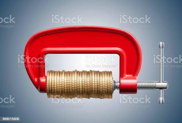 Money Squeeze Clamp With Coins - Fotografie stock e altre immagini di Affari