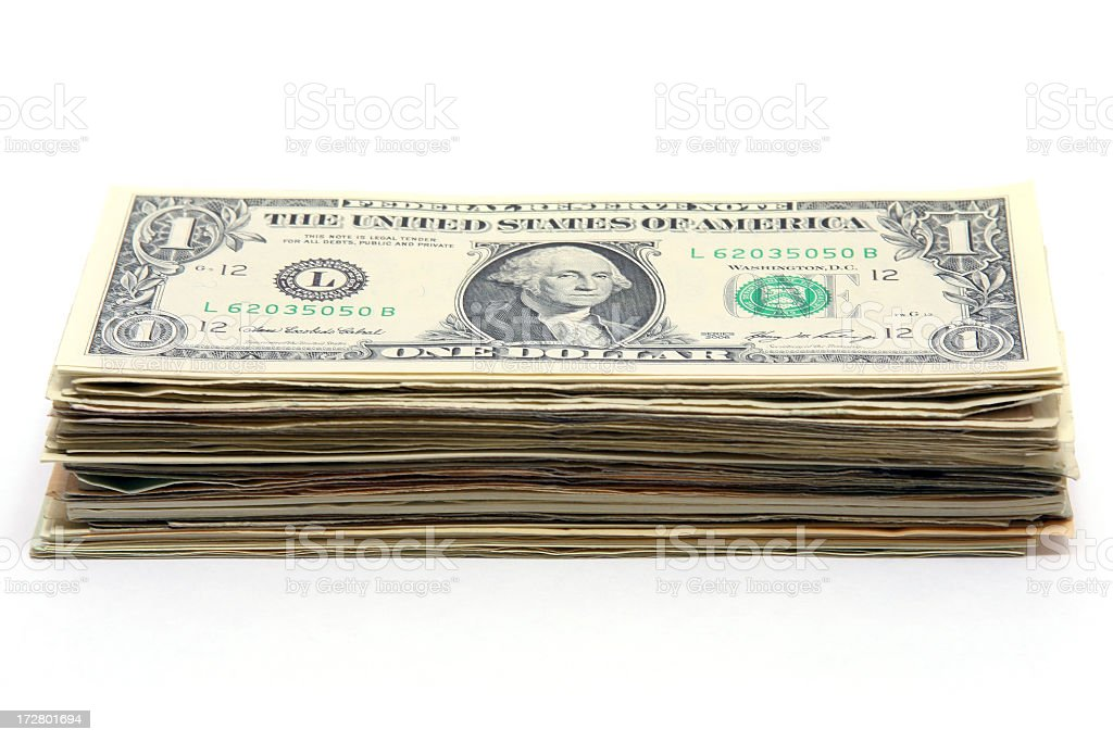 Money stacked up with a one dollar bill on top stock photo