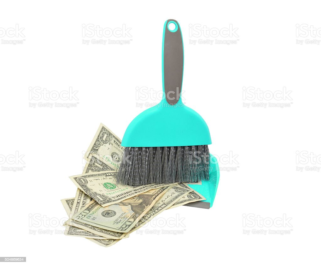 Money Swept into Dustpan stock photo