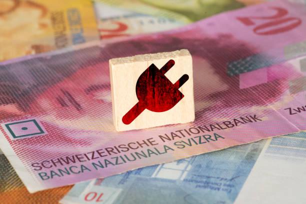 Geld Schweizer Franken und Preis für Strom in Schweiz – Foto