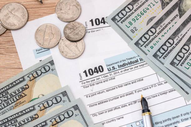 1040 Tax Form With Text April 15 Dollar And Calculator Stock