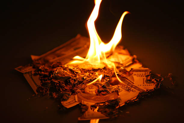 Money to burn  money to burn stock pictures, royalty-free photos & images