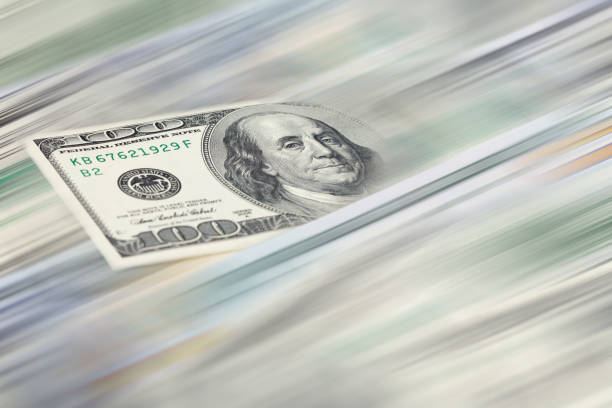 Money transfer concept - $100 US dollar banknote with blurred motion effect. stock photo