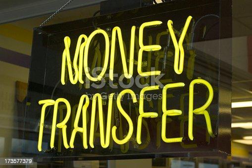 Neon sign depicting money transfer.