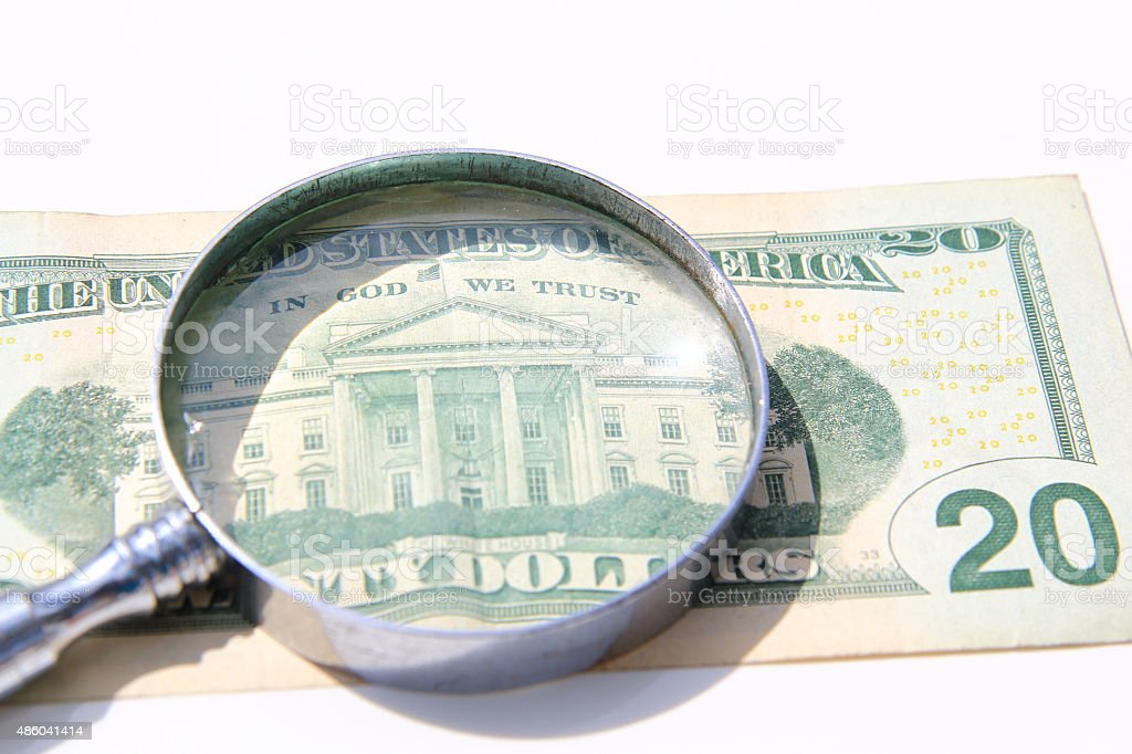 money under magnify glass isolated over white stock photo
