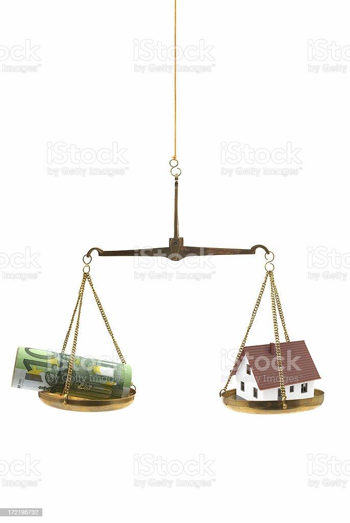 Money Versus Home royalty-free stock photo