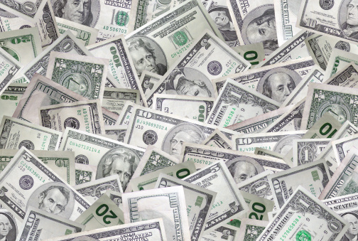 $1, 5, 10, 20, &100 dollar bills and their back sides scattered in a pile. Would make a great background image, super high resolution