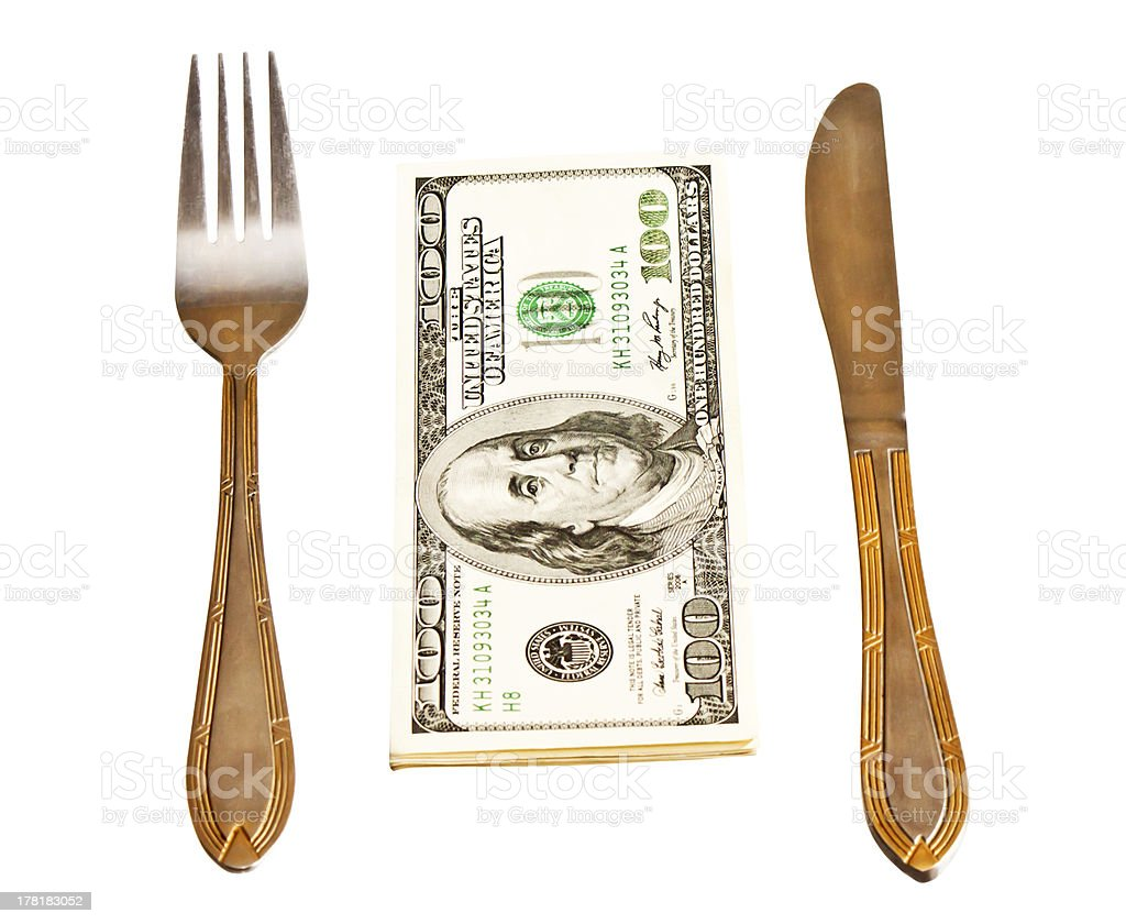 Money with fork and knife, isolated on white background royalty-free stock photo