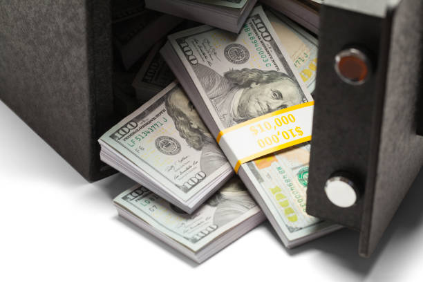 Money With Open Safe Open Safe Full of United States Money. vaulted door stock pictures, royalty-free photos & images
