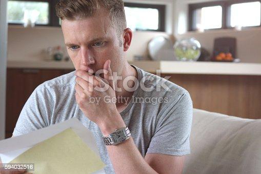 Man reading shocking letter