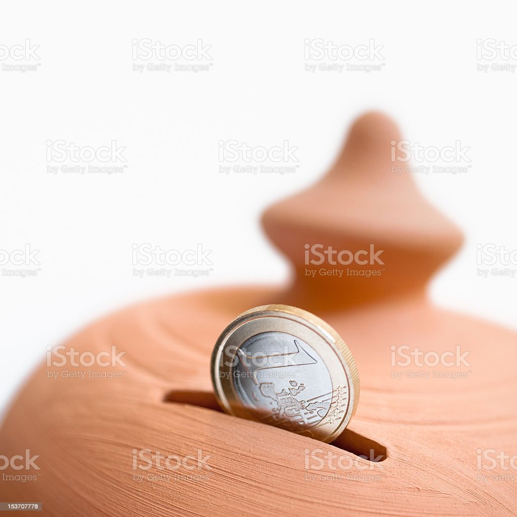 moneybox and coin stock photo