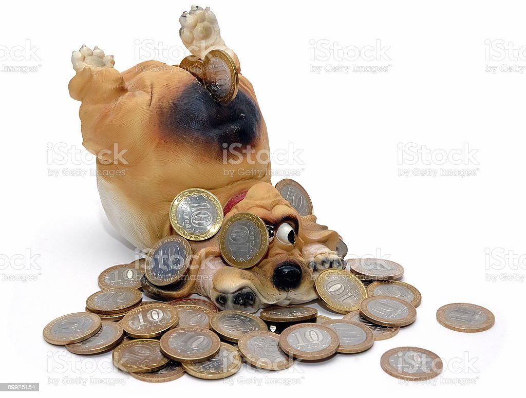 Money-box with coins on white royalty-free stock photo