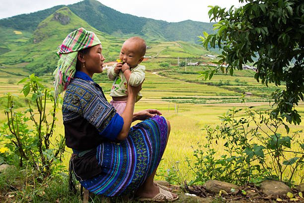 H'mong ethnic minority woman with her son in Mucangchai, Vietnam. stock photo