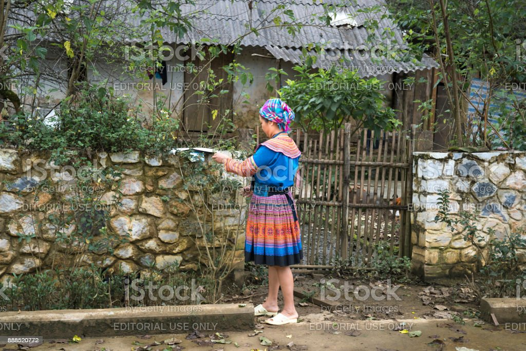 H'mong ethnic minority women in colorful traditional costumes are standing in front of their house in Sa Pa in Lao Cai province, Viet Nam stock photo