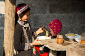 Ha Giang, Vietnam - Feb 14, 2016: Hmong mother feed her son with instant noodle in Dong Van market, Asian