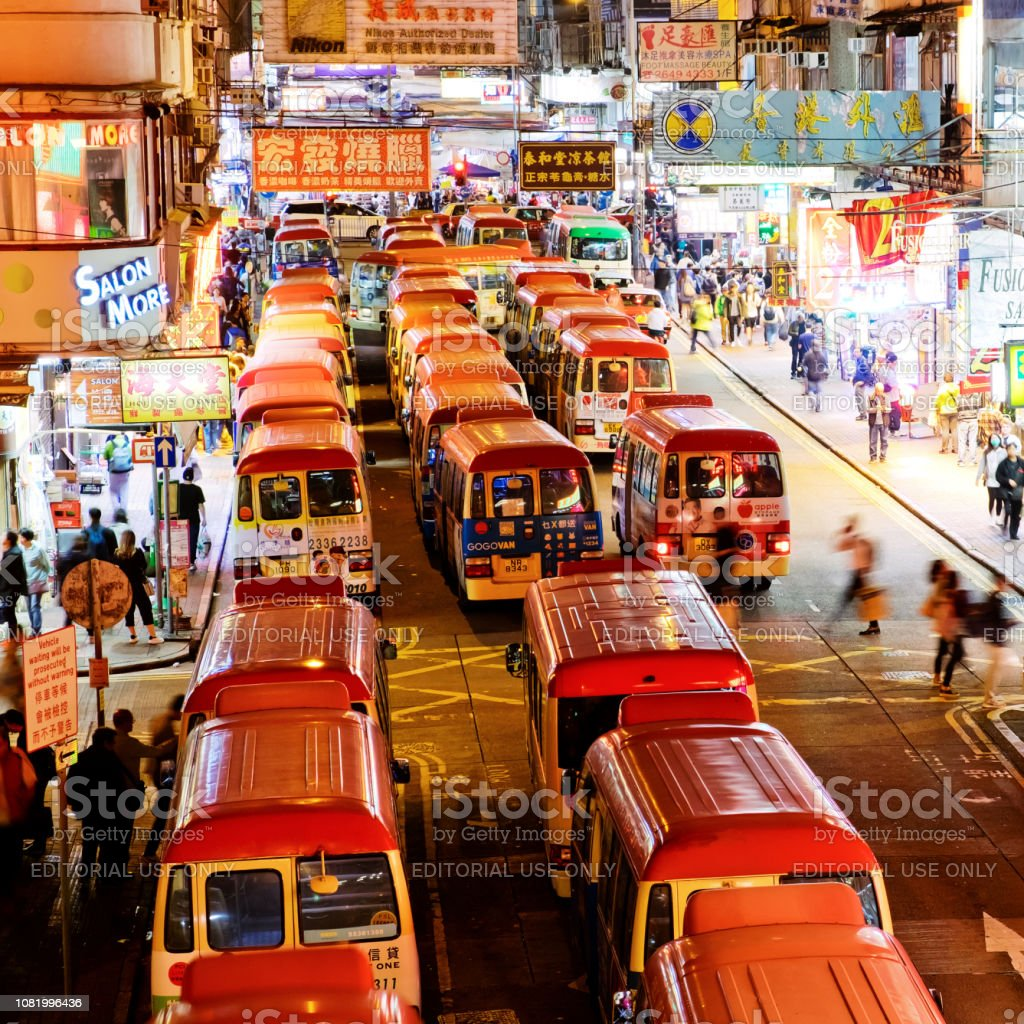 Mong Kok is one of the major shopping areas in Hong Kong Mong Kok, Hong Kong - 07 December, 2018 : Neon lights and traffic in Mong Kok district at night. Mong Kok is one of the major shopping areas in Hong Kong Asia Stock Photo