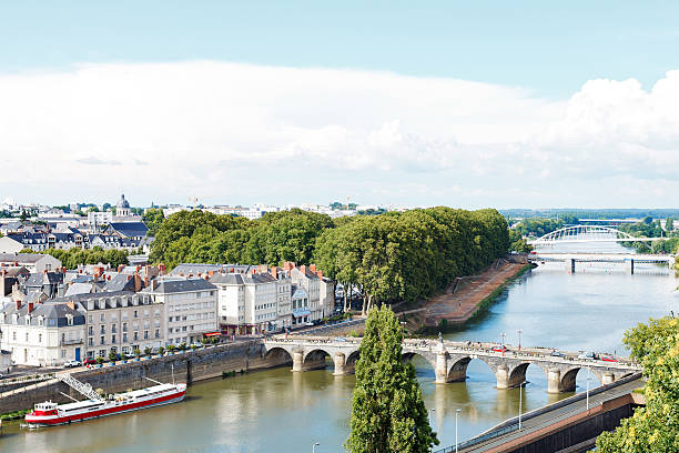 Monge Quai and bridges in in Angers city, France Angers, France - July 28, 2014: Monge Quai, bridges Pont de Verdun and Pont de Haute Chaine on La Maine river in Angers, France. Angers is city is the historical capital of the province of Anjou verdun stock pictures, royalty-free photos & images