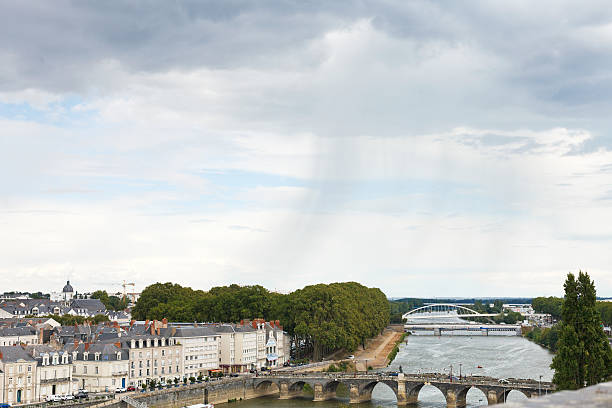 Monge Quai in in Anges city, France Angers, France - July 28, 2014: rain over bridges Pont de Verdun and Pont de Haute Chaine on La Maine river in Anges, France. Angers is city is the historical capital of the province of Anjou verdun stock pictures, royalty-free photos & images