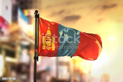 istock Mongolia Flag Against City Blurred Background At Sunrise Backlight 686176186